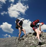 Two hikers. On the rock Stock Photography