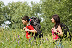 Two hikers. Walking in the grass Stock Images