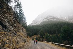 Two hikers in the Alps mountains in winter royalty free stock photos