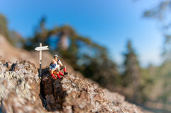 Two hikers with backpack relaxing on top of a mountain. Macro photography Stock Images