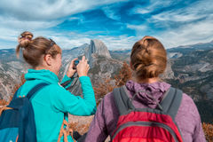 Two hikers with backpacks Royalty Free Stock Photo