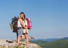 Two hikers enjoying sunrise. Hikers - people hiking, men looking at mountain nature landscape Stock Photos