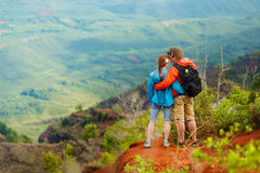 Two hikers enjoying the view from the mountain top Royalty Free Stock Photo