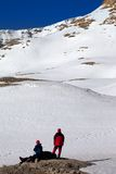 Two hikers on halt in snow mountains Stock Image