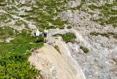 Two hikers on the Hochvogel Mountains in Germany Royalty Free Stock Images