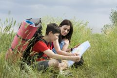 Two hikers with the map Stock Image