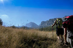 Two hikers in the mountain of Prokletije in Montenegro Royalty Free Stock Images