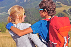 Two hikers in mountains Stock Images