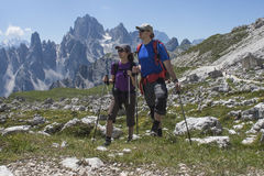 Two hikers in the mountains Stock Photo