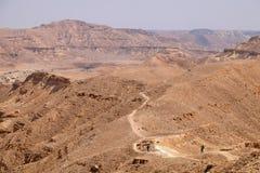 Two hikers in Negev desert. Stock Photos