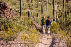 Two Hikers On Rugged Trail Royalty Free Stock Photos