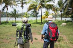 Two hikers out trekking. In the wild Stock Image