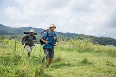Two hikers out trekking. In the wild Royalty Free Stock Photo