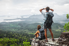 Two hikers relax on top of a mountain Royalty Free Stock Photos