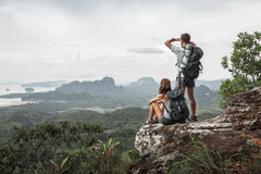Two hikers relax on top of a mountain. With great view Royalty Free Stock Photography