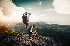 Two hikers relax on top of a mountain. With great view royalty free stock photos
