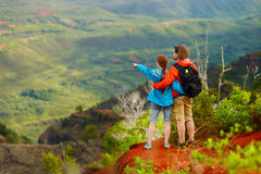 Two hikers relaxing enjoying the amazing view Royalty Free Stock Images