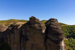 Two hikers on rocks at Meteora rock monasteries, Greece Royalty Free Stock Photos