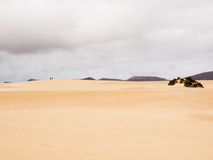 Two hikers at the sand dunes of Corralejo, Fuerteventura, Canary Islands Stock Photo
