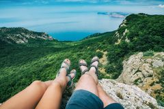 Free Two Hikers Sitting On Mountain Top Royalty Free Stock Images - 151922799