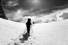 Two hikers on snow plateau. Turkey, Central Taurus Mountains, Aladaglar Anti-Taurus, plateau Edigel Yedi Goller. Black and white landscape Stock Photos