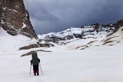 Two hikers at snowy mountains in bad weather. Turkey, Central Taurus Mountains, Aladaglar (Anti Taurus), plateau Edigel (Yedi Goller Stock Photography