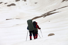 Two hikers on snowy plateau Stock Photography
