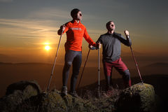 Two hikers on the top of the hill. Two hikers on the mountain summit Stock Photography