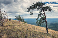 Two hikers on top of the ridge Royalty Free Stock Photo