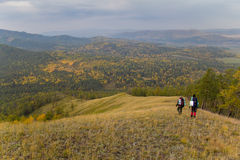 Two hikers traveling along the ridge. On the southern Urals Stock Photos