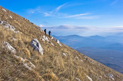 Two hikers on trekking through mountain Rtanj on a sunny day Royalty Free Stock Photography