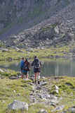 Two hikers walk around the lakes Stock Photo