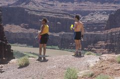 Two hikers with water bottles Royalty Free Stock Image