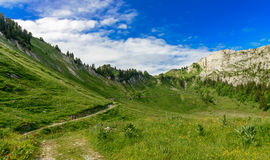 Two hikers women walking in the mountains Royalty Free Stock Photos