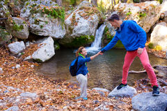Two Hikers young Man and Smiling Woman holding hands Royalty Free Stock Photo