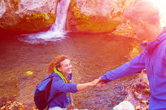 Two Hikers young Man and Smiling Woman holding hands Sunny Royalty Free Stock Image