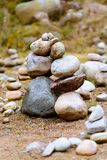 Two hills or pile of stones, similar to two people leaning against each other stock photo
