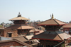 Two Hindu Temple Roofs in Patan, Nepal. The roofs of two Hindu temples in the city of Patan, near Kathmandu, Nepal stock photography