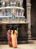 Two hindu women praying in a temple royalty free stock photography