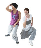 Two hip hop dancers. Two young hip hop dancers posing isolated on white background Stock Photography