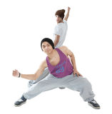 Two hip hop dancers. Two young hip hop dancers posing isolated on white background Stock Photos