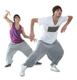 Two hip hop dancers. Two young hip hop dancers posing isolated on white background Royalty Free Stock Image