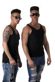 Two hip trendy male friends in studio shot Royalty Free Stock Image