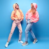 Two hipster Girl Fool Around, Stylish neon Outfit stock image