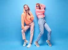 Two hipster Girl Fool Around, Stylish neon Outfit stock photo