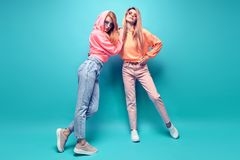 Two hipster Girl Fool Around, Stylish neon Outfit royalty free stock photo