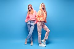 Two hipster Girl Having Fun in Stylish neon Outfit royalty free stock images