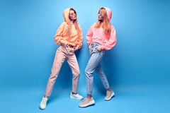Two hipster Girl Having Fun in Stylish neon Outfit stock image
