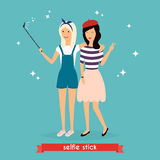 Two hipster girlfriends taking a selfie with stick. Concept of f Stock Photo