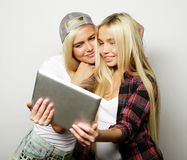 Two  hipster girls friends taking selfie with digital tablet, s Royalty Free Stock Image